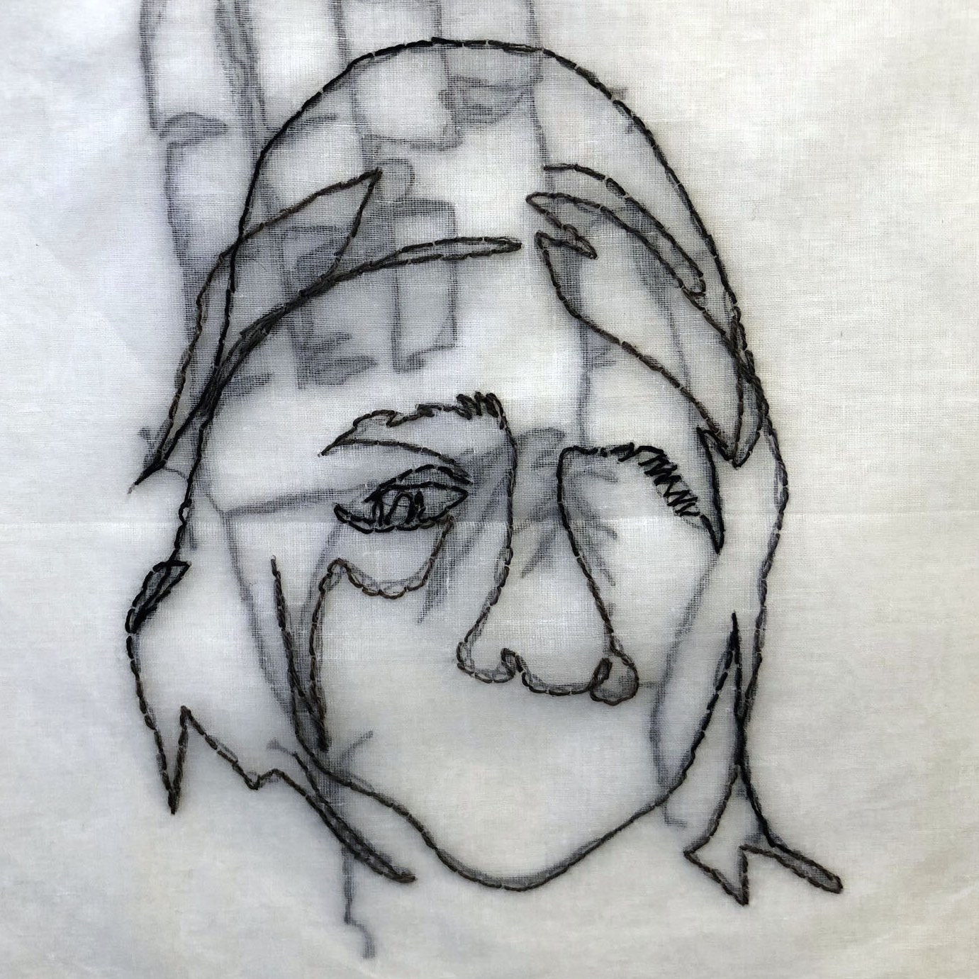 stitched illustration of a face